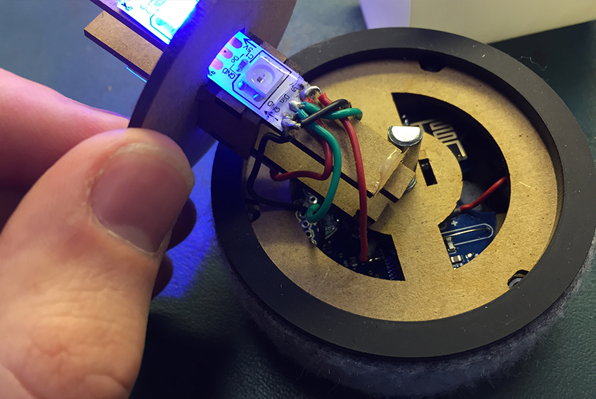 LEDs on a lasercut wooden base, showing wiring going into a PCB
